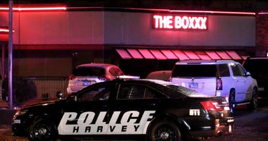 Four men were wounded early Saturday in a shooting at a strip club in Harvey.