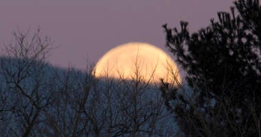 The first supermoon of 2018 sets behind Shenandoah Mountain.