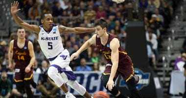 Loyola Ramblers guard Clayton Custer (13) drives against Kansas State Wildcats guard Barry Brown (5)