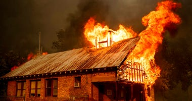 An historic schoolhouse burns as the Carr Fire tears through Shasta, Calif., Thursday, July 26, 2018. Fueled by high temperatures, wind and low humidity, the blaze destroyed multiple homes and at least one historic building.