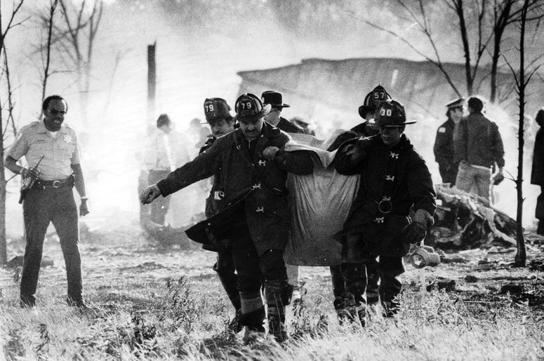 After the flames were doused, firefighters and rescue teams set out to find the remains of victims amid the smoldering debris from the American Airlines Flight 191 accident at O'Hare in May 1979.