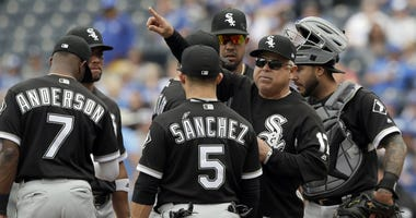 Chicago White Sox manager Rick Renteria (17) calls for new pitcher during the fifth inning of a baseball game against the Kansas City Royals at Kauffman Stadium in Kansas City, Mo., Sunday, April 29, 2018.