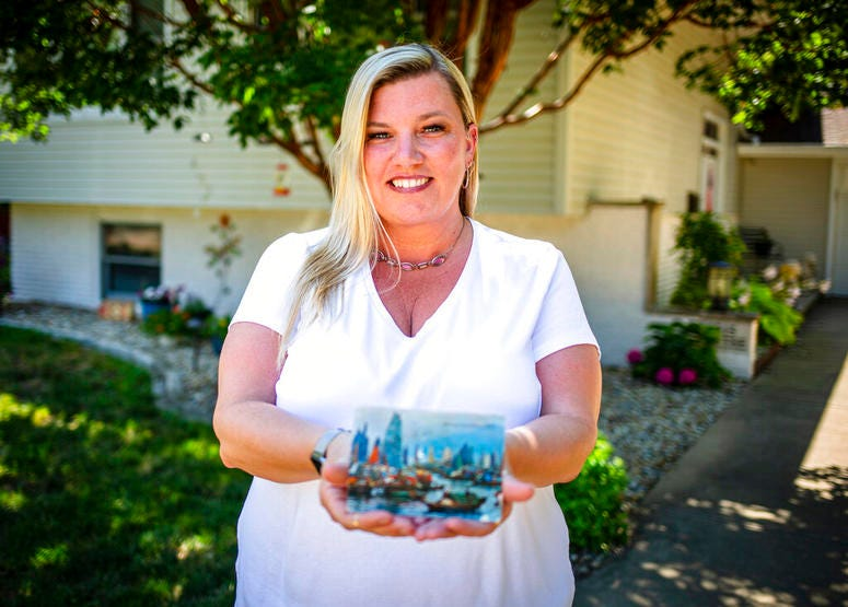 Kim Draper received a postcard at her home in Springfield on July 8, 2019 that was postmarked and sent from Hong Kong exactly 26 years ago on July 8, 1993 to a previous family that lived at her address.