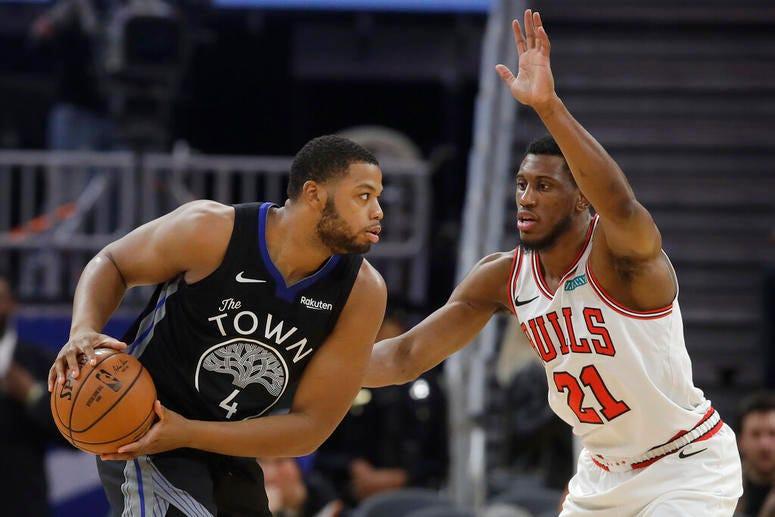 Chicago Bulls guard Kris Dunn drives against Golden State Warriors guard Alec Burks.