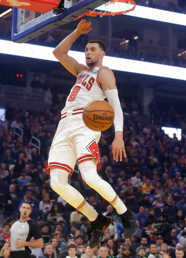 Chicago Bulls guard Zach LaVine dunks against the Golden State Warriors in first half.