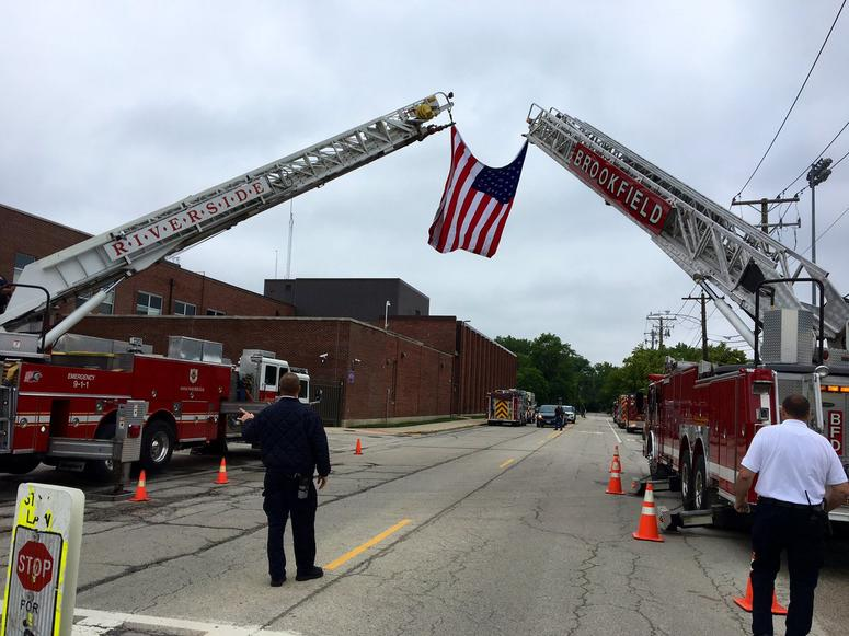 The nearly 60 wounded veterans were greeted by a massive American flag, draped across two ladder trucks from the Riverside and Brookfield Fire Departments outside, and roaring applause from visitors and staff inside.