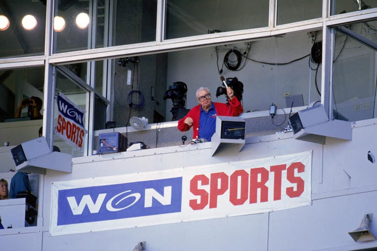 "Harry Caray conducts fans singing ""Take Me Out to the Ball Game"""