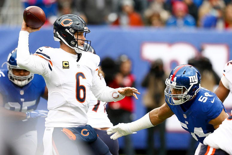 Jay Cutler #6 of the Chicago Bears looks to pass under pressure from Olivier Vernon #54 of the New York Giants during their game at MetLife Stadium on November 20, 2016 in East Rutherford, New Jersey.