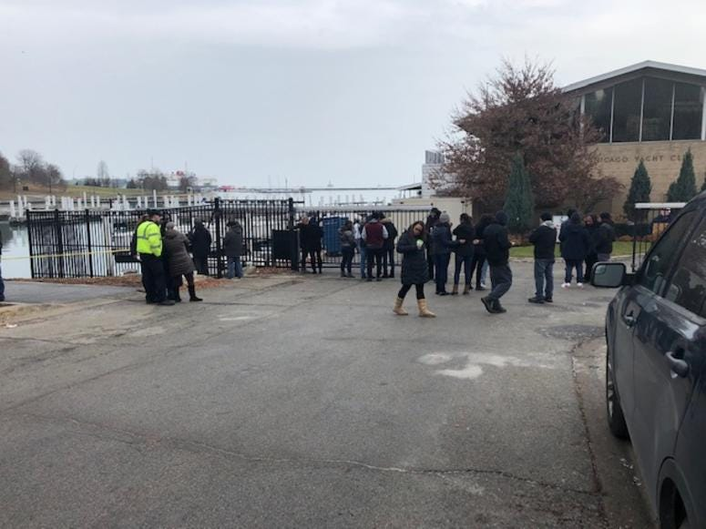 Family waited anxiously Tuesday morning as police recovered two bodies from a submerged vehicle in Lake Michigan possibly linked to two men who went missing from River North over the weekend.