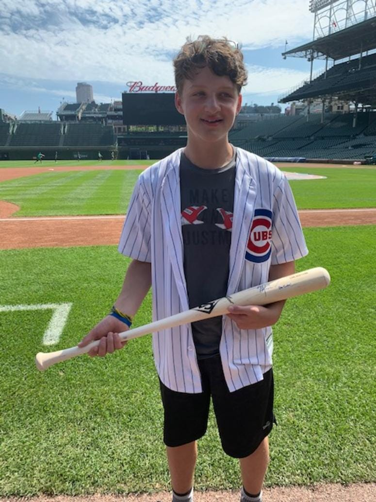 Dylan Provenzano with signed bat from Almora