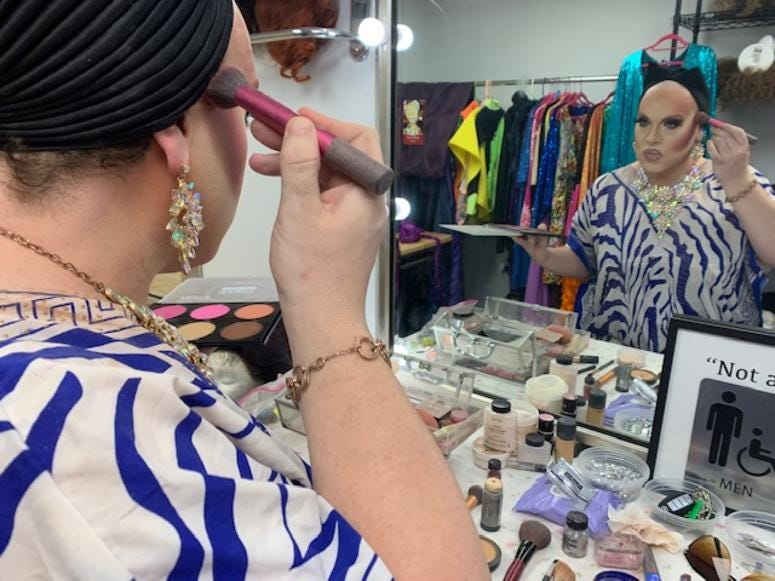 In the dressing room, it takes about two hours to transform Brooks into her alter ego. Her bright colors, her makeup, gowns and wigs, she said, she's found her true self.