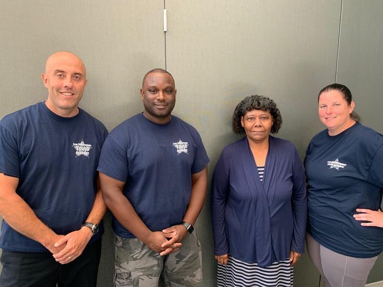 Officer Daniel Gray, Officer Ray Morris, Founder/director Pam Bradley, Officer Nikole Petersen
