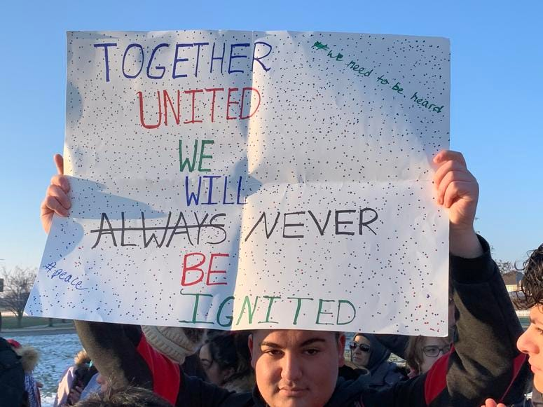 Dozens of mostly Muslim students protested outside a southwest suburban high school Fridaymorning following a fight earlier this week over an anti-Muslim incident.