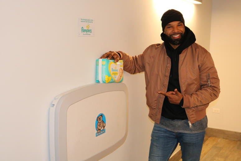 """Matt Forte joined Pampers and Koala Kare on Tuesday to install a baby changing table in the men's bathroom at the field house at Maggie Daley Park, as a part of Pampers """"Love the Change"""" campaign."""