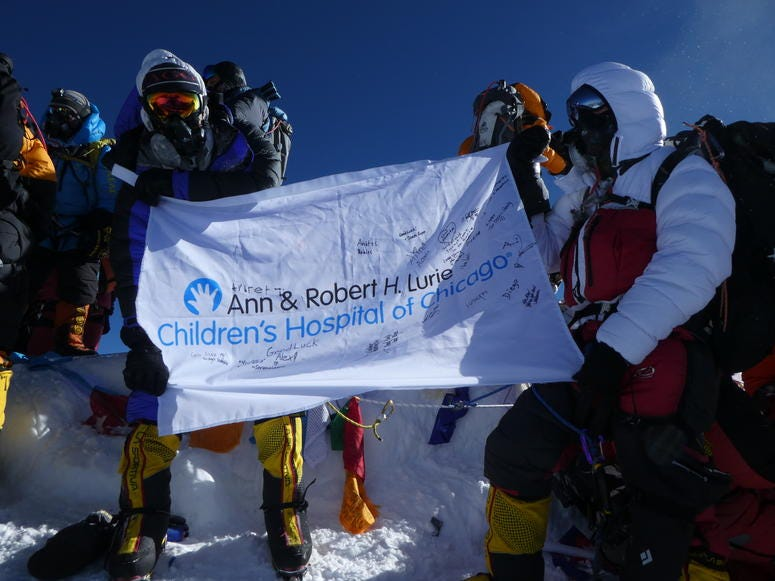 Alex Pancoe with Lurie Children's Hospital flag on Mount Everest
