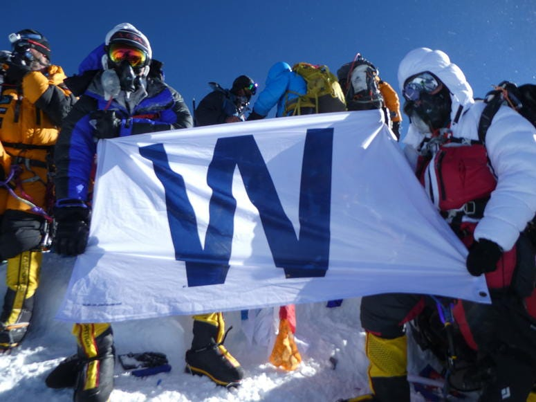Alex Pancoe with the Chicago Cubs 'W' flag on Mount Everest