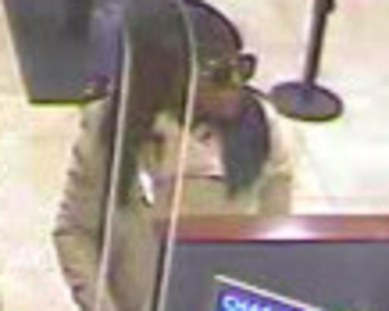 Surveillance image of a woman who robbed a Chase Bank branch April 6, 2019, at 3033 N. Pulaski Road.