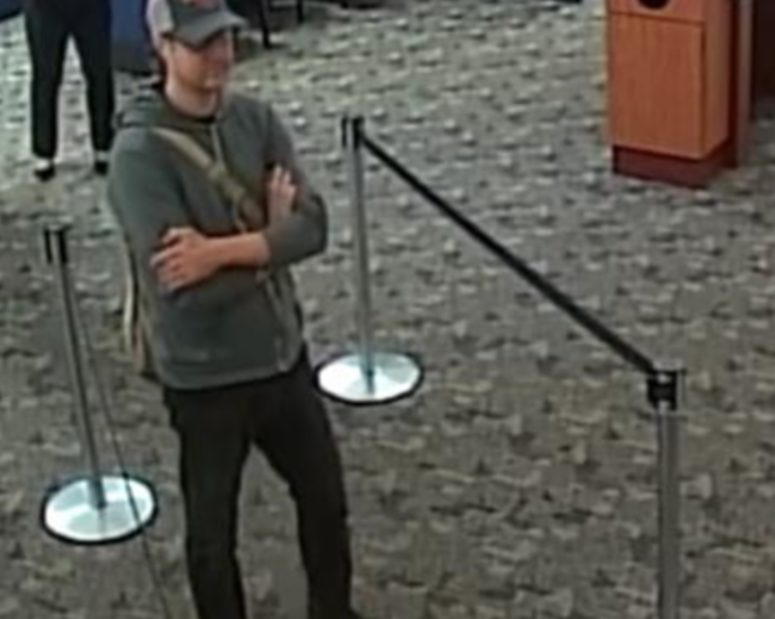 A surveillance photo of a man who robbed three northwest suburban bank branches in less than a month. | FBI