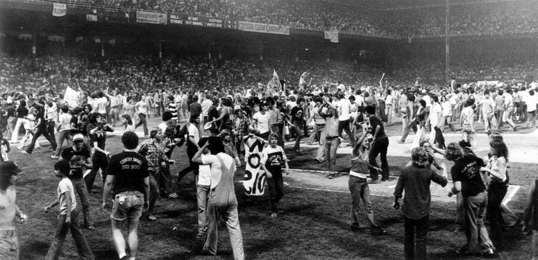 An anti-disco promotion in Comiskey Park in 1979 drew thousands of teens, who poured onto the field between games of a White Sox double-header. The Sox forfeited the second game.