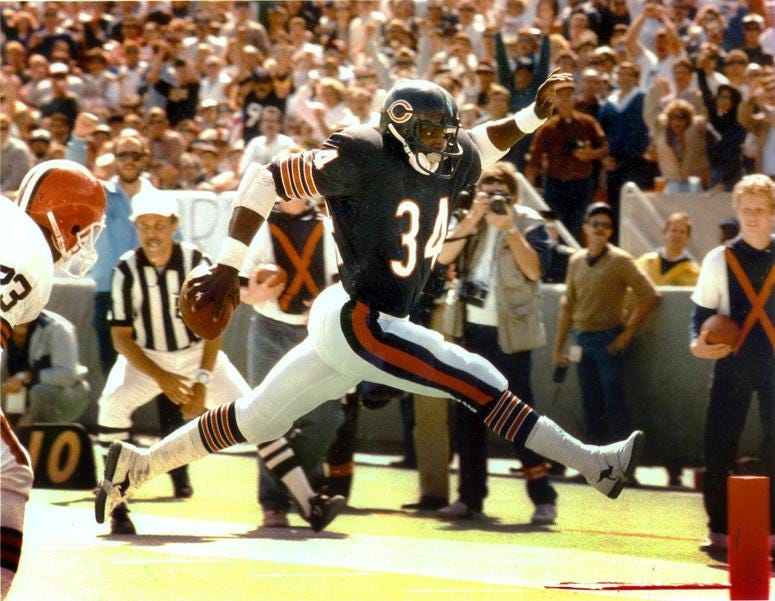 Walter Payton strides into the end zone during a game against the Cleveland Browns in 1986.
