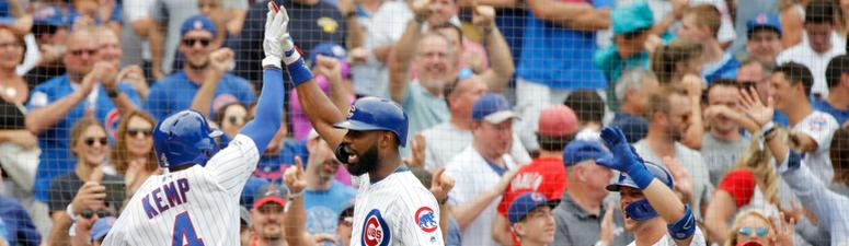 Sep 21, 2019; Chicago, IL, USA; Chicago Cubs second baseman Tony Kemp (4) celebrates his two run home run against the St. Louis Cardinals with center fielder Jason Heyward (22) as shortstop Nico Hoerner (right) looks on during the 7th inning at Wrigley.