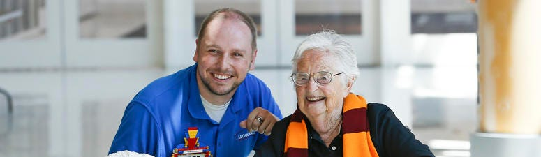 Sister Jean and LEGOLAND Discovery Center's Master Model Builder Greg Nuse