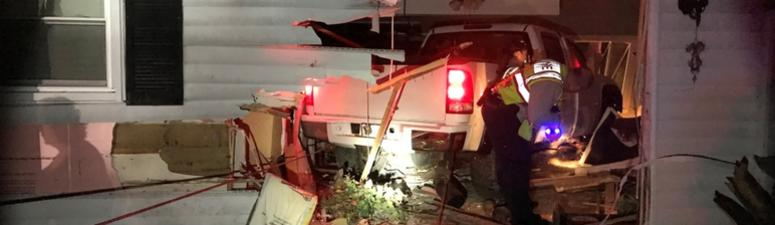Truck Crashes Into House, Pinning Sleeping Occupant