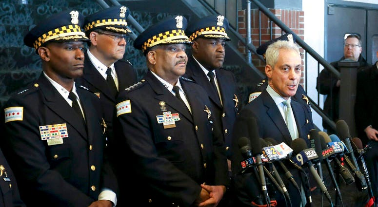 """Chicago Mayor Rahm Emanuel, right, and Chicago Police Superintendent Eddie Johnson, center, appear at a news conference Tuesday, March 26, 2019, after prosecutors abruptly dropped all charges against """"Empire"""" actor Jussie Smollett"""