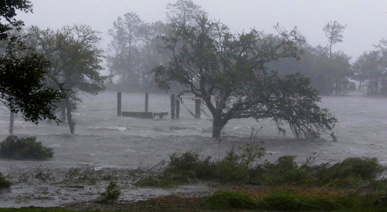 High winds and storm surge from Hurricane Florence hits Swansboro N.C., Friday, Sept. 14, 2018. (AP Photo/Tom Copeland)