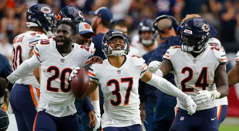 Chicago Bears cornerback Bryce Callahan (37) celebrates his interception against the Arizona Cardinals with Prince Amukamara (20) and Jordan Howard (24) during the second half of an NFL football game, Sunday, Sept. 23, 2018, in Glendale, Ariz. (AP Photo/R