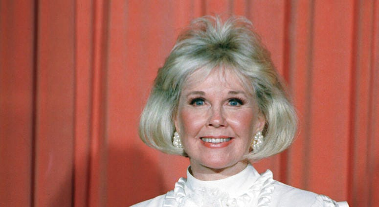 In this Jan. 28, 1989 file photo, actress and animal rights activist Doris Day poses for photos after receiving the Cecil B. DeMille Award she was presented with at the annual Golden Globe Awards ceremony in Los Angeles.