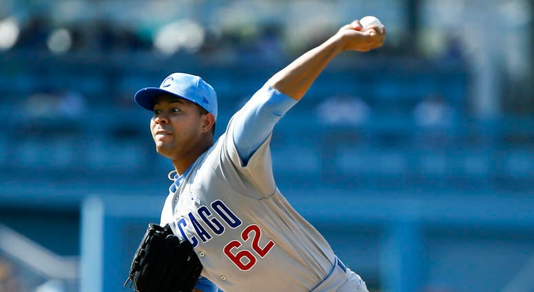Chicago Cubs starting pitcher Jose Quintana throws to a Los Angeles Dodgers batter during the first inning of a baseball game in Los Angeles, Sunday, June 16, 2019.