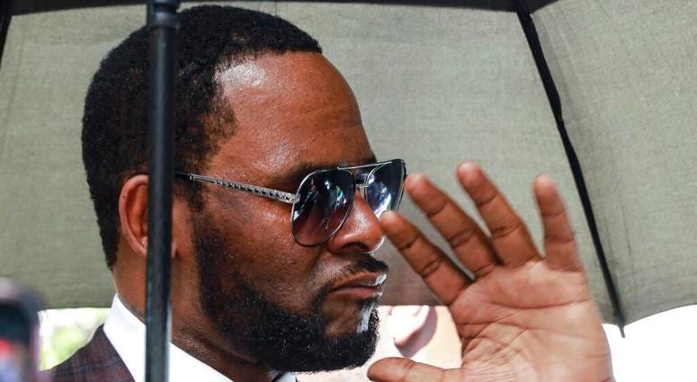 R. Kelly departs from the Leighton Criminal Court building after a status hearing in his criminal sexual abuse trial in Chicago.