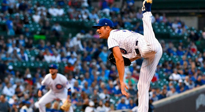 Chicago Cubs starting pitcher Cole Hamels watches a throw during the first inning of the team's baseball game against the San Francisco Giants on Tuesday, Aug. 20, 2019, in Chicago.