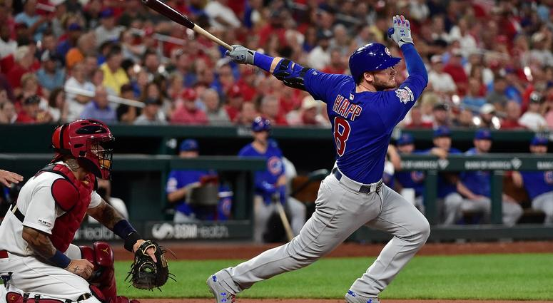 Chicago Cubs third baseman Ian Happ (8) hits a one run double off of St. Louis Cardinals relief pitcher Andrew Miller (not pictured) during the seventh inning at Busch Stadium.