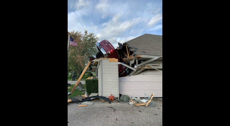 Police say a Wisconsin man was arrested after crashing a pickup truck into the roof of a Beloit home.
