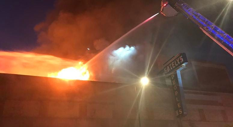 Firefighters are tackling a three-alarm fire at a commercial building in Roseland.