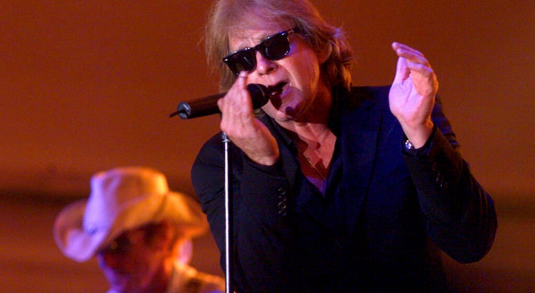 In this Aug. 6, 2004 file photo, Eddie Money performs during Grandstand Under the Stars at the Diamond Jo Casino in Dubuque, Iowa.