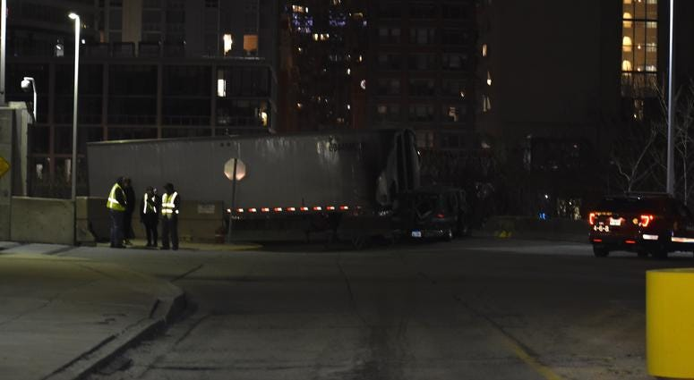 Authorities investigate the scene of a fatal crash on Dec. 15, 2019 in the 400 block of West Polk Street in the South Loop. Carly Behm/Sun-Times