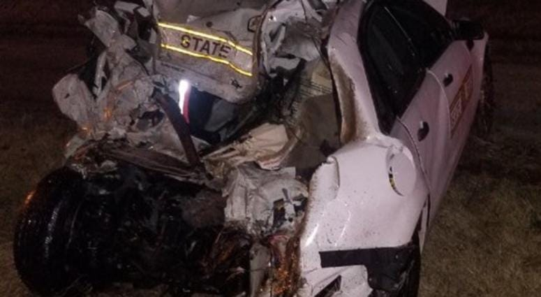 An Illinois State Police trooper was seriously injured when he and his squad car were hit by a semi Wednesday night in downstate Collinsville.