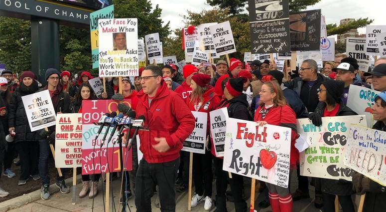 Chicago Teachers Union President Jesse Sharkey joined teachers and support staff Friday on the picket line at Lane TechCollege Prep High School.