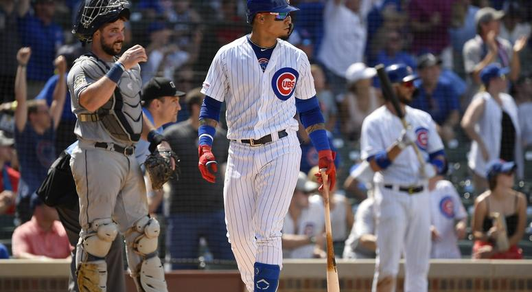 Chicago Cubs shortstop Javier Baez (9) watches his two run home run ball leave the park in front of San Diego Padres catcher Austin Hedges at Wrigley Field July 20, 2019.
