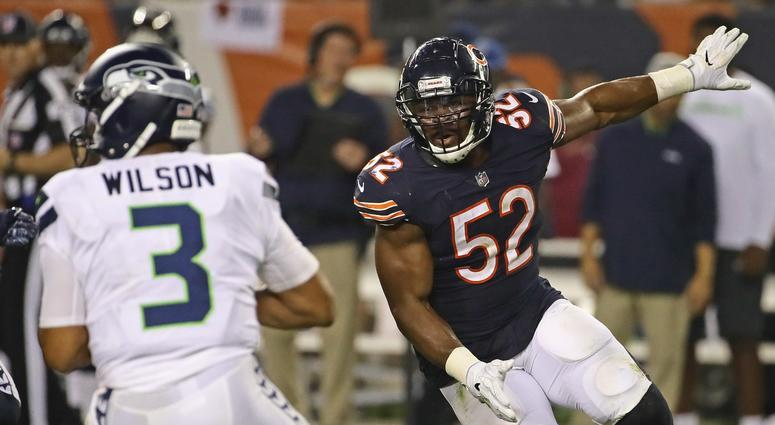Bears outside linebacker Khalil Mack, right