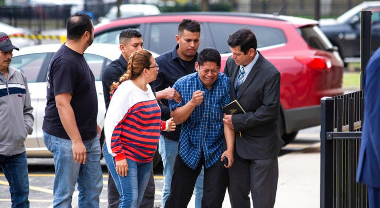 Arnulfo Ochoa, the father of Marlen Ochoa-Lopez, is surrounded by family members and supporters, as he walks into the Cook County medical examiner's office to identify his daughter's body, Thursday, May 16, 2019 in Chicago