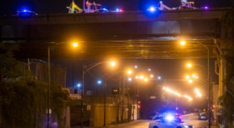 Illinois State police investigate a section of the expressway Saturday morning, near Canal Street and 26th Street where a person was shot.
