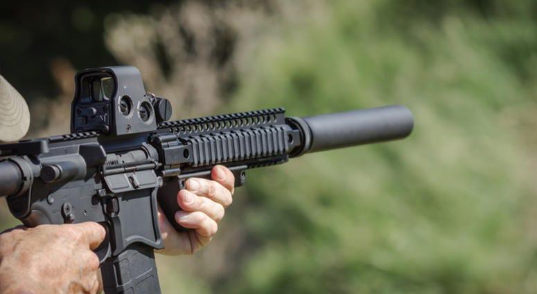 Gun with bump stock