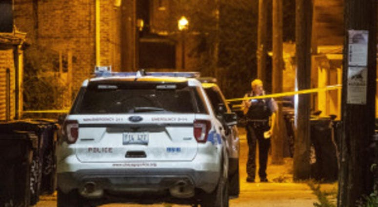 Police investigate an alley where a man was shot in the back Friday morning in the 3500 block of South Hoyne. A second scene thought to be related to this shooting was found a few block away in the 3200 block of South Hamilton.