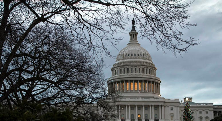 The Capitol is seen on the first morning of a partial government shutdown, as Democratic and Republican lawmakers are at a standoff with President Donald Trump on spending for his border wall, in Washington, Saturday, Dec. 22, 2018