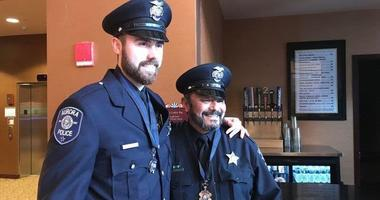 Two Aurora police officers have returned to full duty nearly nine months after being wounded in a mass shooting at the Henry Pratt Company.