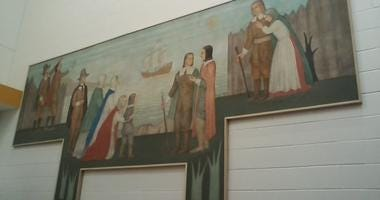 Depression era mural repaired and restored at Freeman Elementary School
